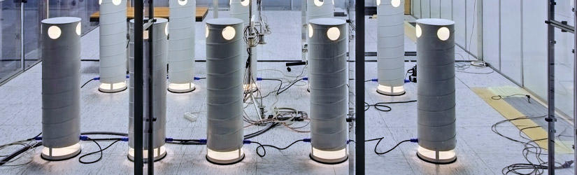 Experimental setup in the air flow laboratory with some dummies placed around a table